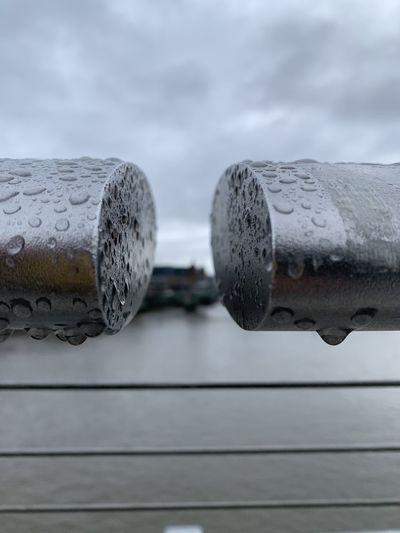 Close-up of raindrops on railing