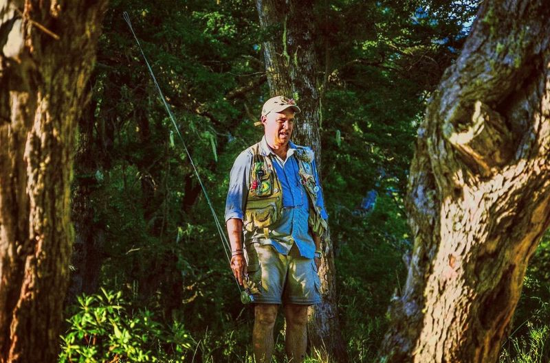Dad never grow up // Standing Tree One Man Only Only Men One Person Nature Outdoors Peace And Quiet Color Photography Nature Agameoftones Green Color PortraitPhotography Portrait Retrato Patagonia Patagonia Argentina Argentina Argentina Photography Flyfish Album Flyfishing  Flyfishingnation Flyfish Flyfishingaddict Pesca The Portraitist - 2018 EyeEm Awards A New Beginning
