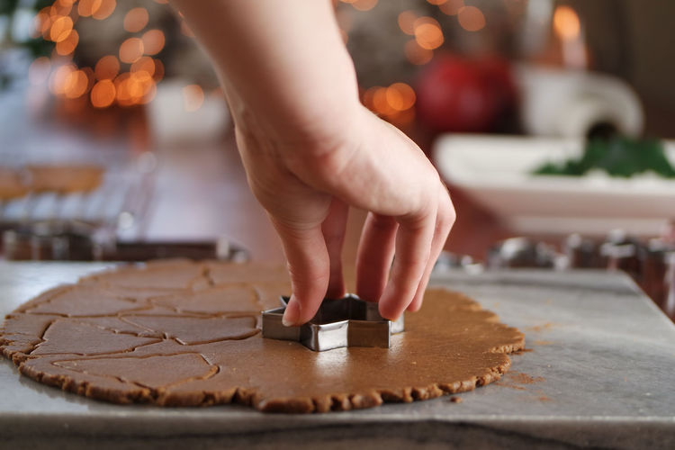 Close-up of hand making cookie