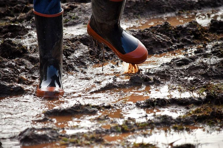 Low Section Human Body Part Human Leg Outdoors Day One Person Real People Water One Woman Only Adult Nature Adults Only People Close-up Walking Children Fun Tradition Rubber Boots Puddles Puddleography Boots Childhood Puddle