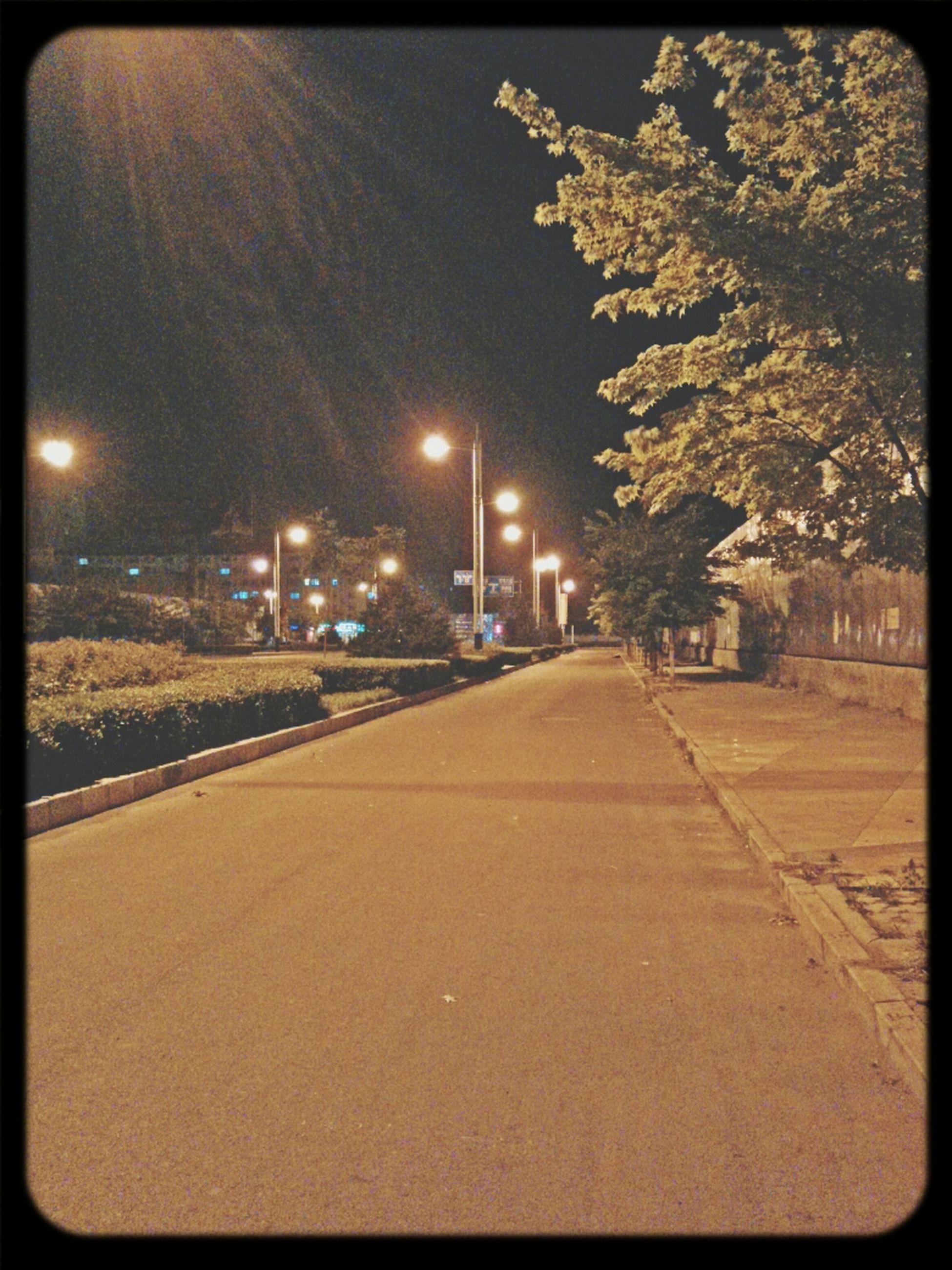 transfer print, auto post production filter, night, the way forward, building exterior, illuminated, architecture, built structure, street light, sky, tree, road, diminishing perspective, street, empty, outdoors, city, vanishing point, no people, lighting equipment