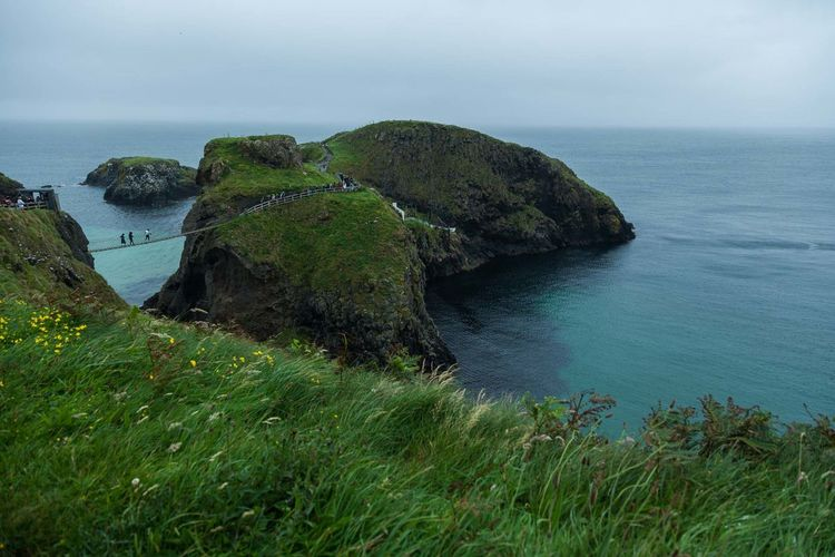 Atlantic Ocean Carrick-a-Rede Rope Bridge Causeway Bay Ireland Ireland Landscapes Nature Northern Ireland Rope Bridge Tourist Travel Beauty In Nature Day Nature Nature_collection Ocean Outdoors Real People Scenics Tourism Attraction Tourism Destination Travel Destinations Water