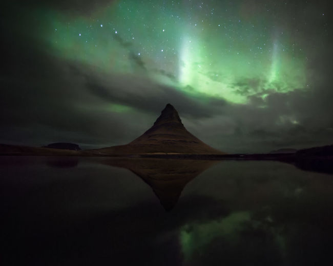 Aurora borealis in Iceland. Aurora Borealis Iceland Kirkjufell Beauty In Nature Cloud - Sky Dramatic Sky Environment Idyllic Lake Landscape Mountain Nature Night No People Non-urban Scene Reflection Scenics - Nature Sky Tranquil Scene Tranquility Water Waterfront