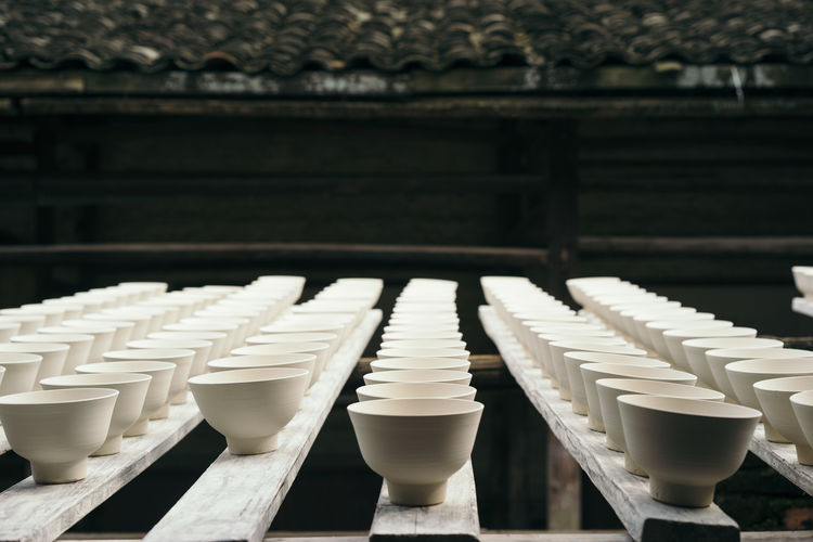 Porcelain containers arranged on wooden planks