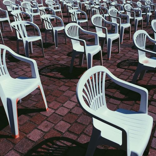 Chaises. Chair Empty In A Row Striped High Angle View Table No People Outdoors Day The City Light