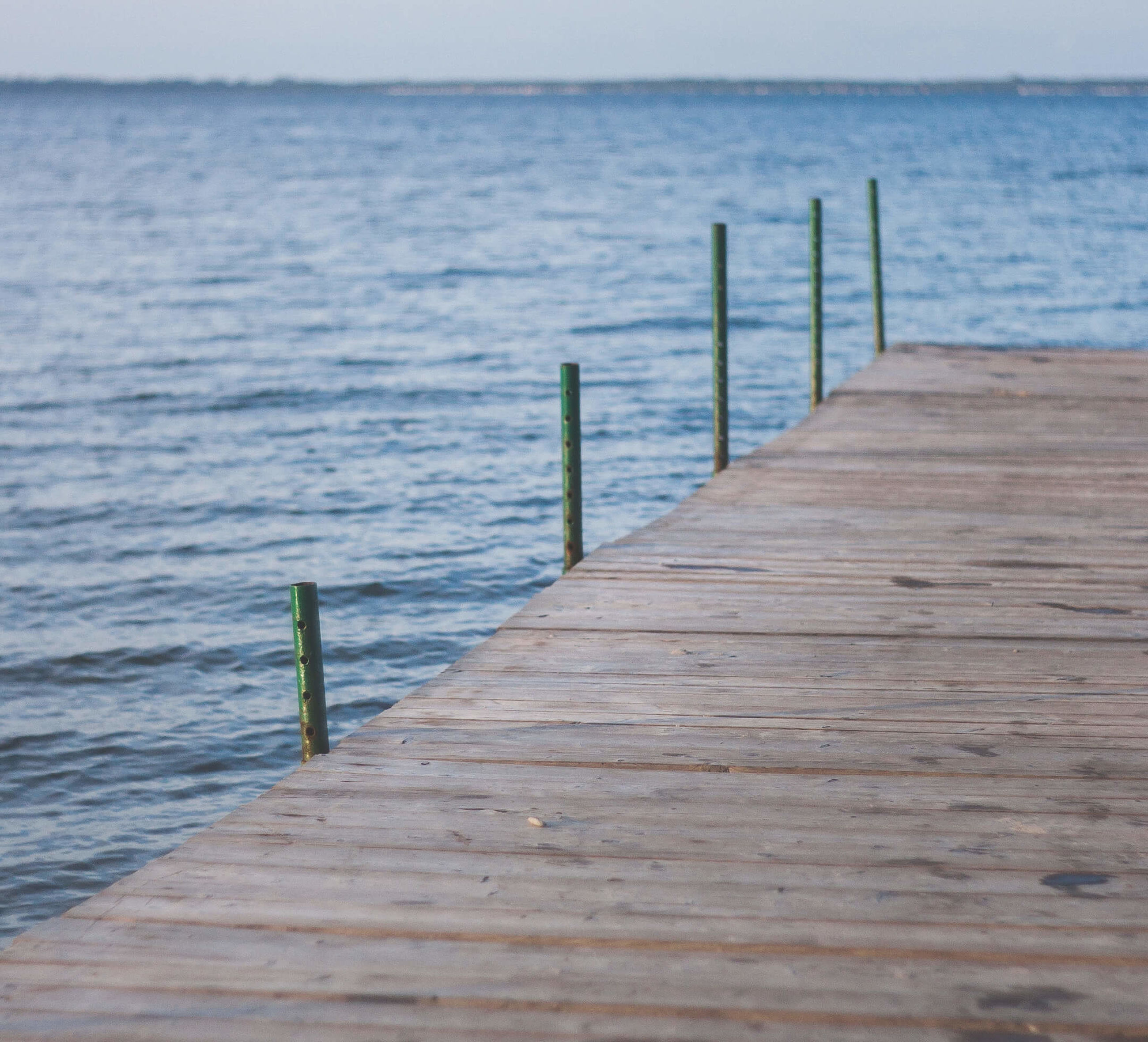 water, sea, pier, wood - material, horizon over water, scenics, railing, jetty, tranquility, nature, tranquil scene, travel destinations, boardwalk, beauty in nature, the way forward, day, non-urban scene, sky, no people, tourism, seascape, ocean