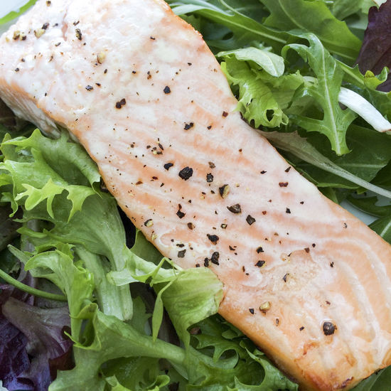 Baked Salmon steak on a bed of leaves Baked Black Pepper Close-up Fish Food Food And Drink Freshness Green Color Healthy Eating High Angle View Leaf Leaf Salad Leaves Meal Organic Salad Salmon Seasoned Steak Still Life