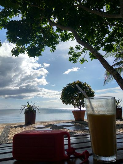 No Filter Tree Water Sea Sky Drink Nature No People Vacations Tranquility Drinking Glass Scenics Beach Beauty In Nature Freshness Day Outdoors Eyeem Philippines Bicol, Philippines Vacations Mangoshake Speaker Cloud - Sky Cloud Plants