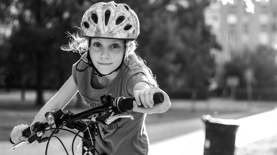 Black & White FUJIFILM X-T10 From My Point Of View Black And White Photography Childhood Close-up Day Elementary Age Focus On Foreground Fujifilm Girls Headwear Leisure Activity Lifestyles Looking At Camera Nature One Person Outdoors People Portrait Real People Sports Helmet Wasiak Young Adult