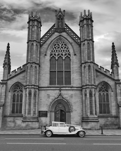 Wedding car Wedding Car, White Car, Church Exterior, Black And White Arch Architecture Building Exterior Built Structure Cloud - Sky Day Façade History No People Outdoors Place Of Worship Religion Sky Spirituality Travel Destinations