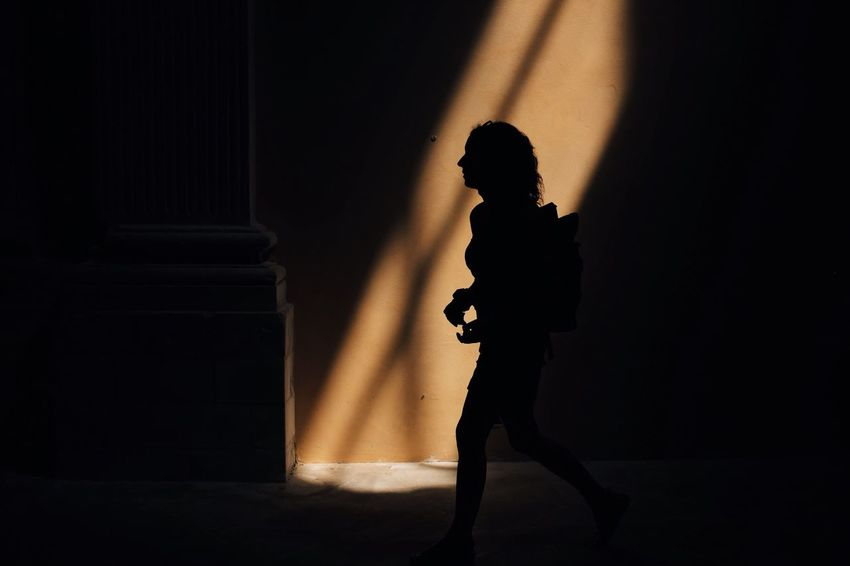 EyeEm Selects Shadow One Person Standing Indoors  Silhouette Composition Light The Week On EyeEm FujiX100T Shadows & Lights Light And Shadow Natural Light Atmospheric Mood Sunlight Real People Architecture The Week On EyeEm The Week On EyeEm