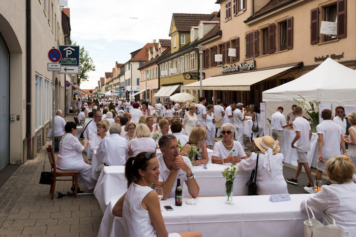 Ludwigsburg, Germany - July 30, 2016: People are enjoying le diner on blanc – the white dinner – where all guests are asked to dress in white, dining at white tables in Ludwigsburg near Stuttgart, Germany. Diner En Blanc Dinner Event Festive Germany Lifestyles Ludwigsburg People White