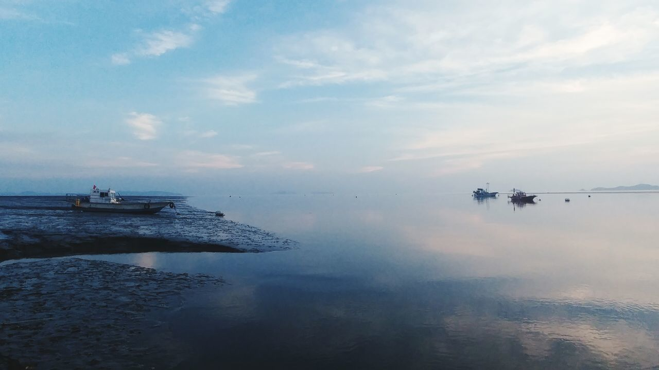 cloud - sky, sky, water, nature, transportation, outdoors, day, men, beauty in nature, scenics, real people, nautical vessel, people