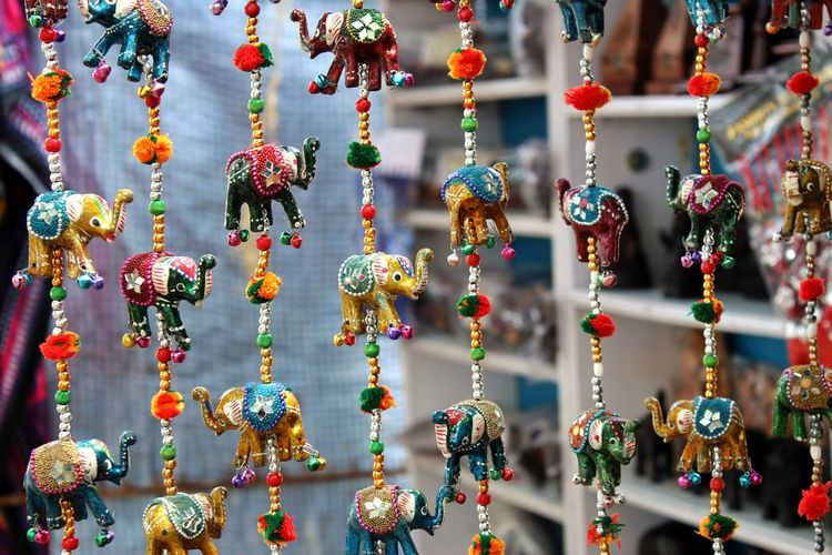 Close-up of hanging for sale in market