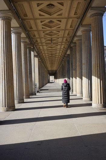 Rear view of woman walking on corridor