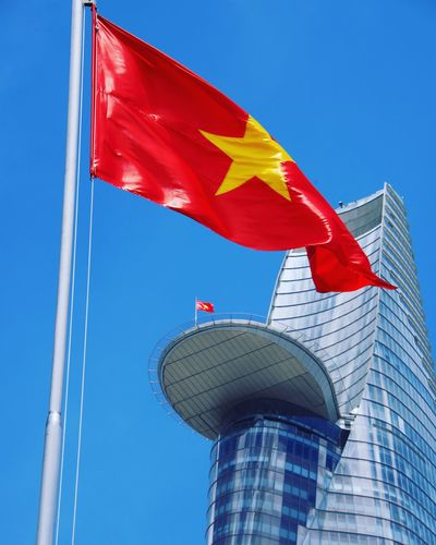 ASIA Ho Chi Minh City Viet Nam Flag Patriotism Low Angle View Sky Blue Nature Wind Day Red No People Clear Sky Built Structure Outdoors Architecture