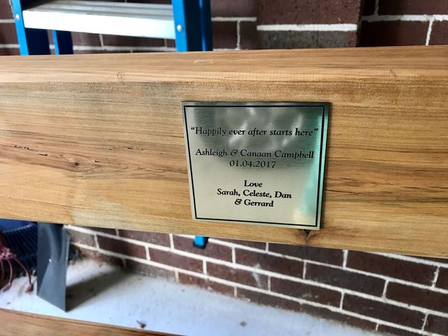 A plaque was made for the new happy couple. Wedding Present Plaque Message Chair Craftmanship Handmade Furniture Love Finishedwork Eyeem Furniture No People Built Structure Wooden Chair Furniture Maker Close Up
