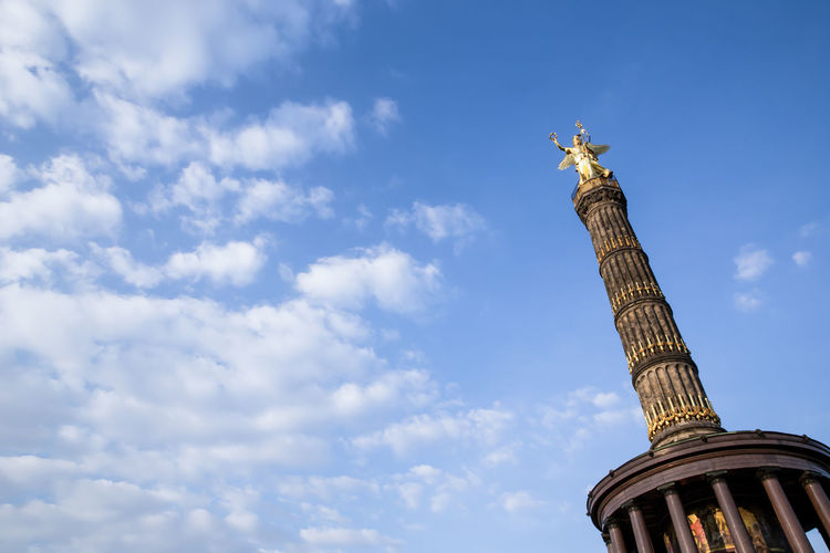 Low angle view of victory column against blue sky