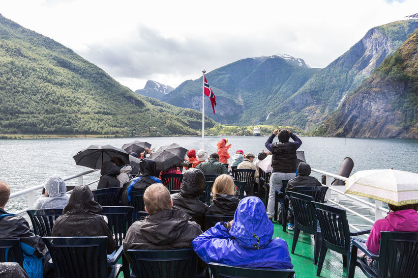 Tourists on a sightseeing ferry Cloudy Cruise Deck Ferry Fjord Holiday Landscape Mountain Mountain Range Outdoors Overcast People Raining Feel The Journey Ship Sightseeing The Tourist Top Deck Tourists Travel Travel Photography Umbrellas Upper Deck Vacations Flåm