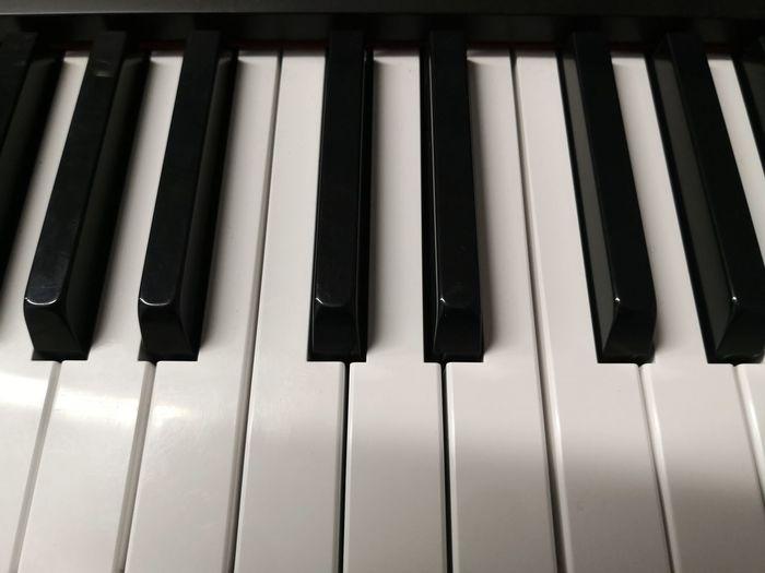 High angle view of piano keys