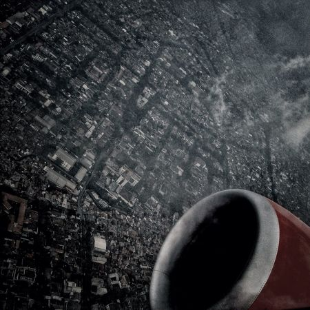 The city From An Airplane Window Travelling Monochrome Sky