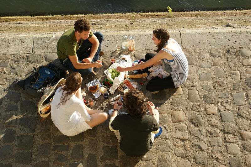 Adults Only Bonding Casual Clothing City Communication Cooperation Day Directly Above Friendship Full Length Happiness High Angle View Leisure Activity Mid Adult Men Outdoors Paris People Picnic Sitting Sunlight Teamwork Togetherness Two People Young Men Young Women