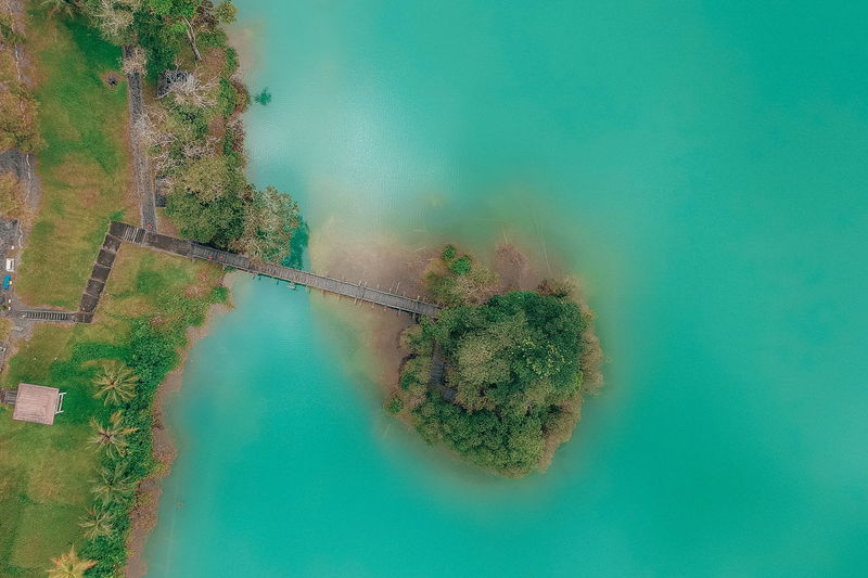 Beauty In Nature Water Plant Nature No People Day Green Color Tree Scenics - Nature High Angle View Tranquility Tranquil Scene Growth Land Reflection Turquoise Colored Outdoors Non-urban Scene Wall - Building Feature