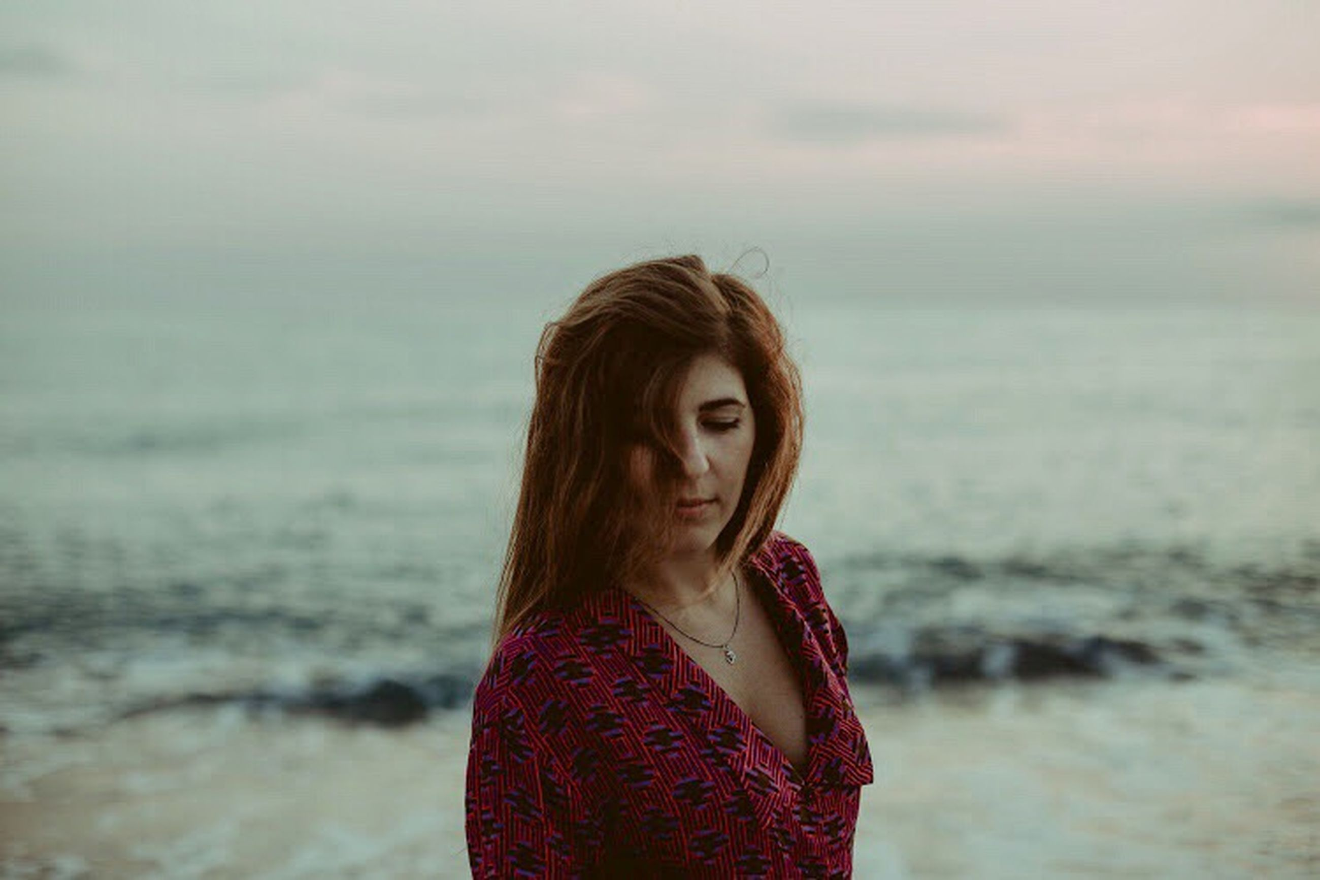 water, sea, one person, portrait, beach, land, beauty, young adult, hairstyle, standing, hair, nature, leisure activity, casual clothing, focus on foreground, brown hair, contemplation, beautiful woman, outdoors