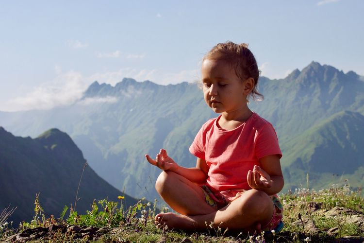 Exercise Meditating Meditation Top Yoga Beauty In Nature Child Childhood Cross-legged Innocence Leisure Activity Lifestyles Lotus Position Mind  Mindfulness Mountain Mountain Range Nature One Person Outdoors Sitting Sky Tranquility