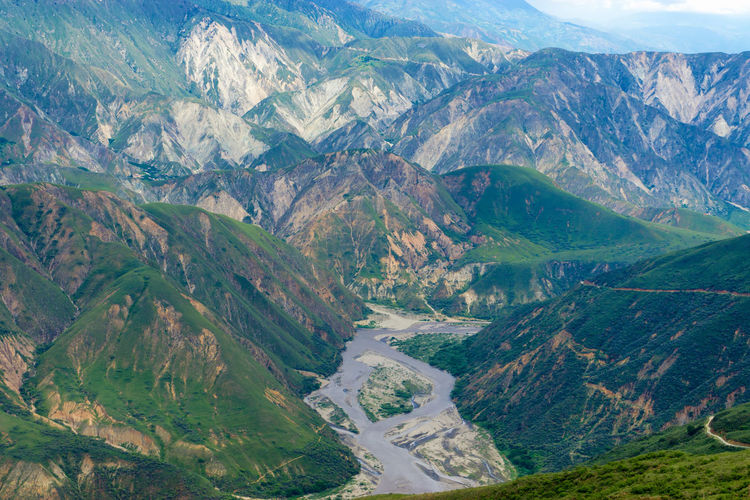 View of rugged Chicamocha Canyon in Santander, Colombia America Bucaramanga Canyon Chicamocha Cliff Colombia Day Hill Landscape Mountain National Nature Outdoor Panachi Park River Rock Santander Scene Scenic South Tourist Travel Tree View