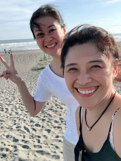 Portrait of smiling young women at beach