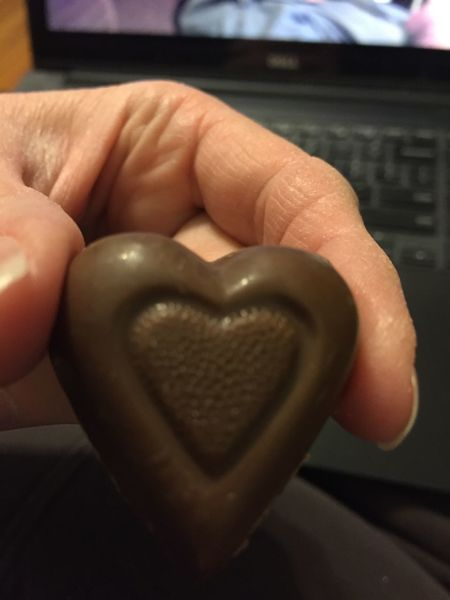 Chocolate heart Candy Chocolate Chocolate Candy Chocolate Heart Day Dessert Focus On Foreground Food Heart Shape Holding Human Body Part Human Finger Human Hand Indoors  Valentine's Day