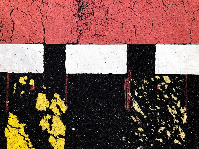 Colorful street markings in the city Background Texture Street Asphalt Sign Marking Red Black Full Frame Road Road Marking Sign Symbol Transportation Marking Asphalt High Angle View Day White Color No People Backgrounds City Striped Street Textured  Pattern Close-up Yellow