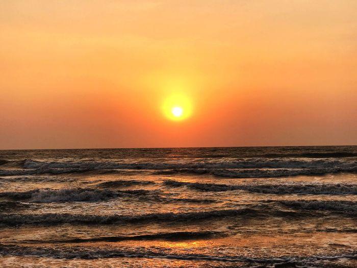 Sunset Sky Sea Water Beauty In Nature Scenics - Nature Horizon Over Water Orange Color Horizon Tranquility Tranquil Scene Sun Beach Idyllic Land Nature No People Sunlight Non-urban Scene Outdoors