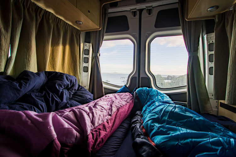 waking up camping in new zealand with a beautiful sea view. View Camper Campervan Day Indoors  Journey Land Vehicle Lifestyles Mode Of Transportation Moring New Zealand Real People Relaxation Sea View Sky Sleeping Sleeping Bag Transportation Travel Two People Vehicle Interior Vehicle Seat Window Windows The Traveler - 2018 EyeEm Awards Summer Road Tripping