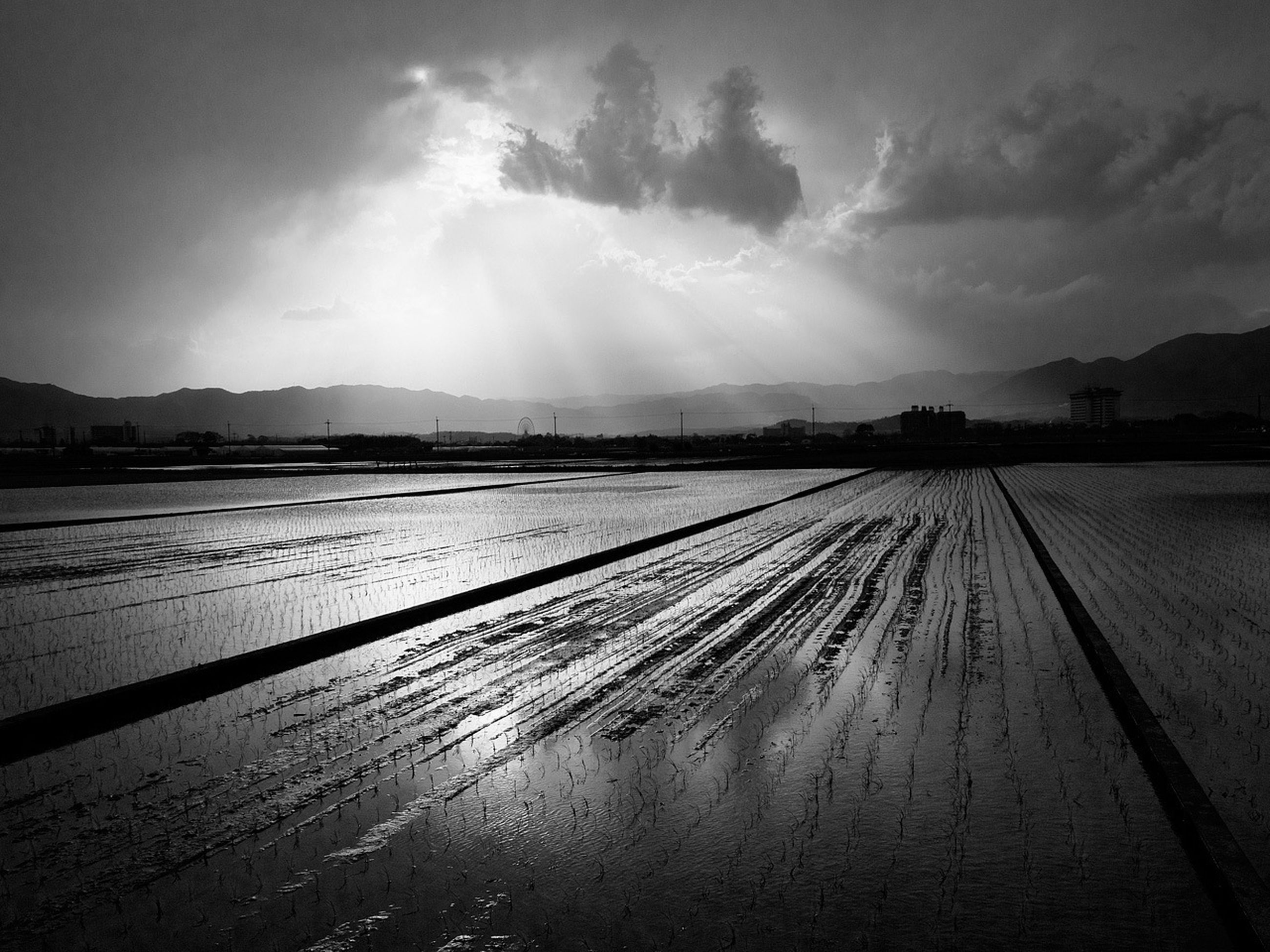 sky, cloud - sky, landscape, tranquil scene, tranquility, weather, snow, scenics, winter, cold temperature, nature, cloudy, beauty in nature, field, cloud, sunbeam, tire track, sunlight, sun, the way forward