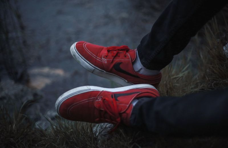 Nature Low Section Shoe Real People One Person Nike Nike✔ Kicks Human Leg Outdoors Lifestyles Field Day Human Body Part Grass Close-up People Sunset Selective Focus