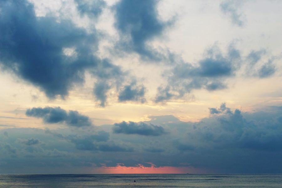 A Bali sunset Sky Scenics Horizon Over Water Tranquil Scene Tranquility Nature Cloud - Sky Water Beach Sunset Day Horizon Outdoors Beauty In Nature No People Landscape