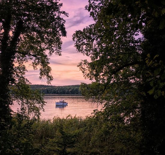 boat at anchor in the evening. Beauty In Nature Boat Day Evening Lake Lake View Lakeshore Lakeside Landscape Nature No People Outdoor Outdoors Purple Purple Sky Scenics Sky Sundown Sunset Tranquil Scene Tranquility Tree Trees Trees And Sky Water