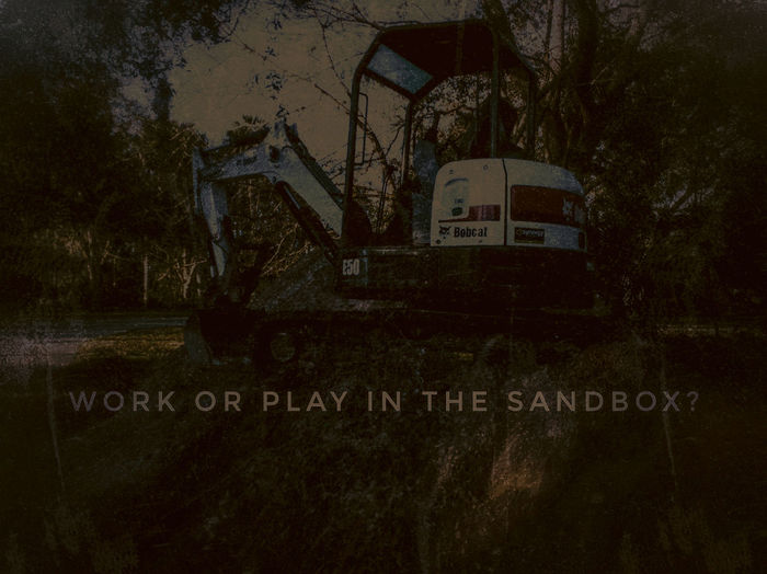Work or Play? Background Dim Background Boys And Their Toys Construction Machinery Construction Vehicle Construction Vehicles Construction Site Sandbox Work Or Play Background Backgrounds Faded Background Dark Text Western Script Communication No People Outdoors Day Sky