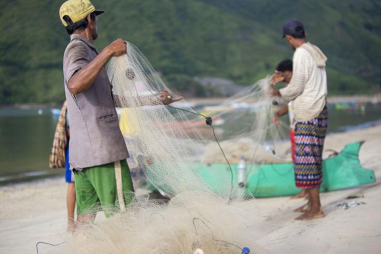 Fishermen working at beach