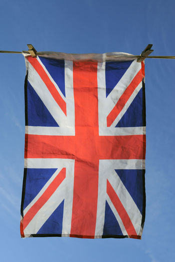 Low Angle View Of British Flag Hanging Against Sky