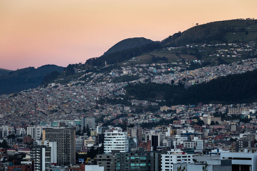 Rucu Pichincha Architecture Beauty In Nature Building Exterior Built Structure City Cityscape Clear Sky Crowded Day Mountain Mountain Range Nature Outdoors Pichincha Scenics Sky Sunset Urban This Is Latin America