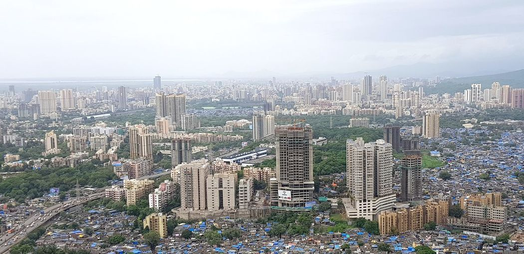 High angle view of modern buildings in city against sky
