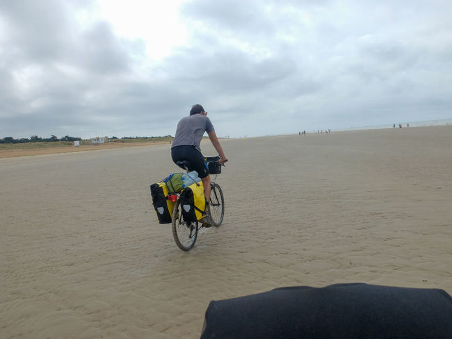 Adventure By Bike Bicycle Bike Packing Bike Touring Cloud - Sky Day Full Length Men Nature One Man Only One Person Outdoors People Real People Rear View Riding Sky Velodyssee