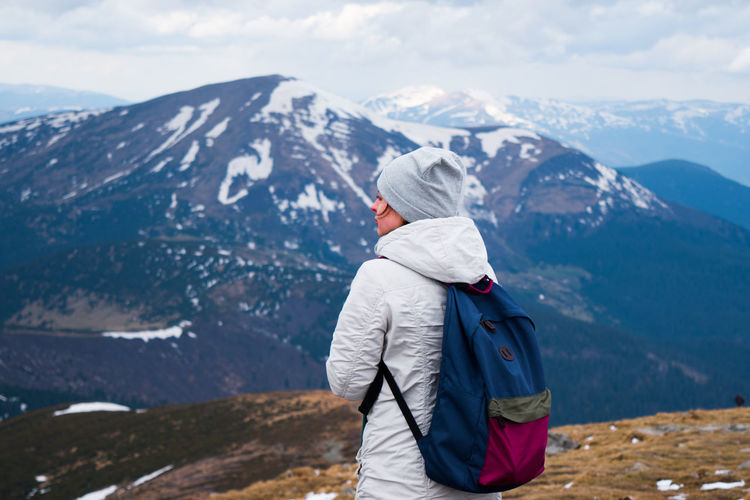 Tourist standing on mountain