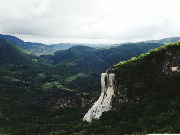 EyeEm Selects Hierve El Agua Mountain Cloud - Sky Pinaceae Pine Tree Landscape Nature Beauty In Nature Scenics Mountain Range Forest No People Travel Destinations Tree Outdoors With A View Petrifiedwaterfall Shotzdelight Somewhere In Mexico Oaxaca, México New On Eyeem Wanderlust Day Sky