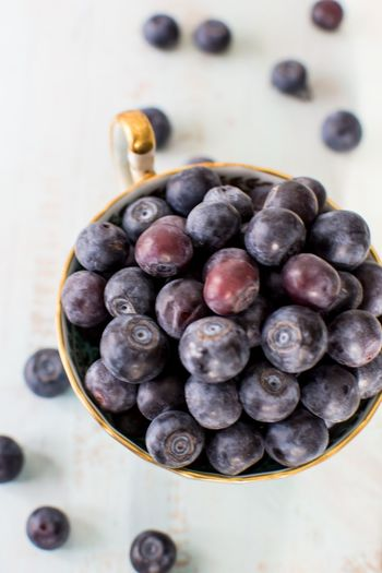 Fresh blueberry cup in vintage gold tea cup closeup high angle view antioxidant rich blueberries Background Gold Blueberries Blueberry No People Food And Drink Blueberry Freshness Healthy Eating Close-up Food Large Group Of Objects Indoors  Fruit Day