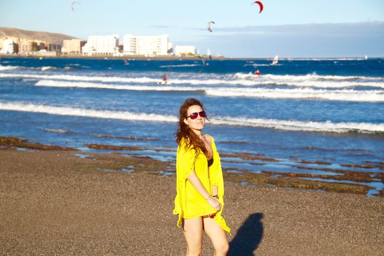 Woman In Yellow Dress Top At Beach On Sunny Day