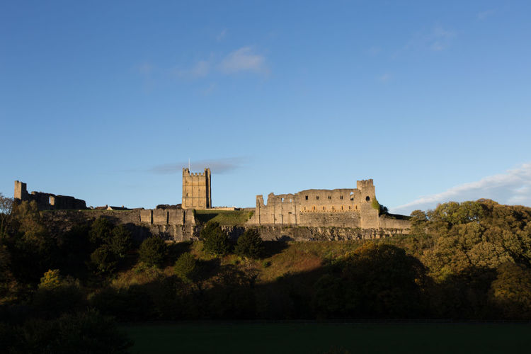 Richmond Castle, Richmond, North Yorkshire, UK History The Past Sky Architecture Built Structure Castle Fort Building Exterior Nature Tree No People Travel Destinations Building Plant Day Travel Ancient Blue Water Outdoors Blue Sky Evening Light Richmond North Yorkshire Copy Space Tower